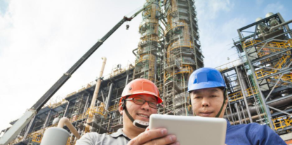 Employees reading safety guidelines at a chemical manufacturing plant